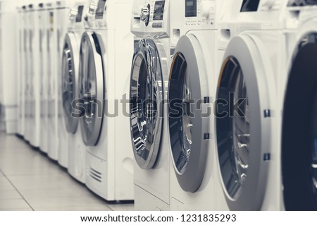 Row of washing mashines in appliance store #1231835293