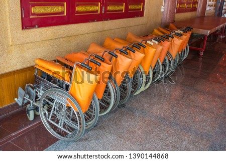 Row of wheelchairs for older people and older patients in chinese temple.