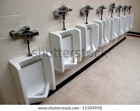 Row of white clean urinals in public restroom - stock photo
