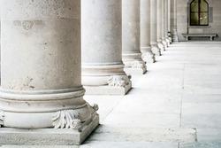 Row of white marble columns. Greek marble pillars detail