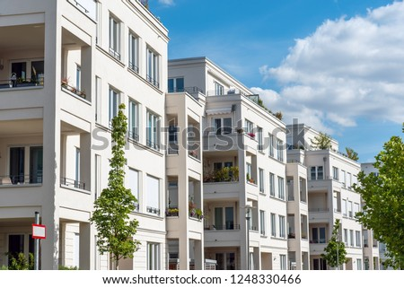 Row of white modern apartment houses seen in Berlin, Germany