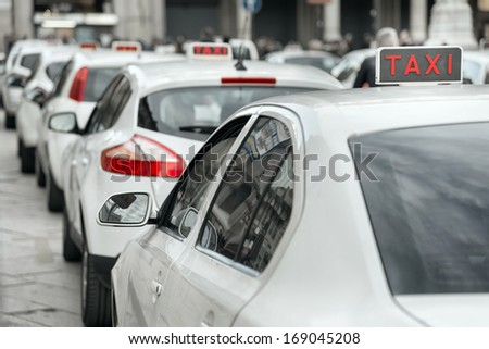 row of white taxi