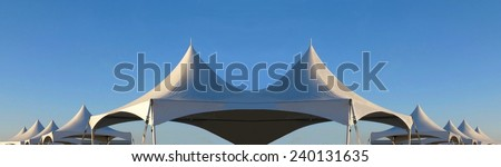 row of white tent tops #240131635