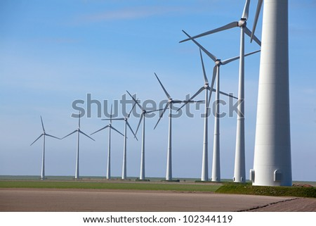 Row of wind turbine producing alternative energy