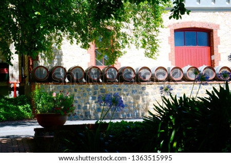 Row of wine barrels in quaint cottage style winery gardens. #1363515995
