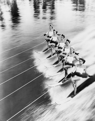 Row of women water skiing