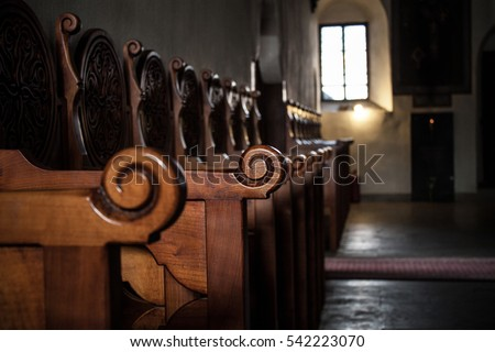 Row of wooden benches inside a church in Spain. #542223070