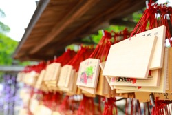 Row of wooden plaque, as called ema, using for communicating wishes to god in Daizaifu Tenmangu shrine, Japan