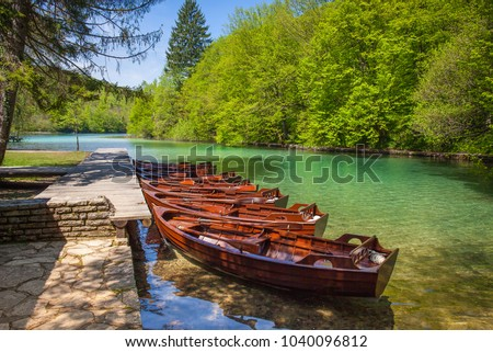 Row of wooden rowboats waiting for tourists, Plitvice National Park, Croatia