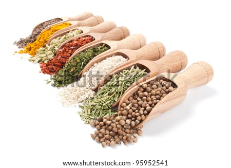 Row of wooden shovels with spices in them. Diminishing perspective