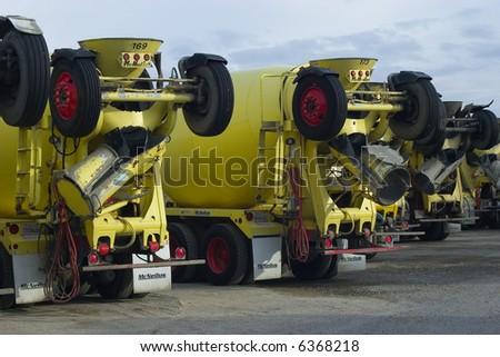 row of yellow cement trucks