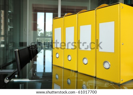 row of yellow folders on desk in office