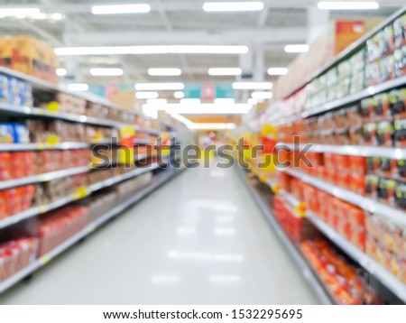 row variety consumer product on shelves in store at supermarket, concept blurred background.