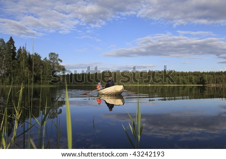 Rowboat on lake - stock photo