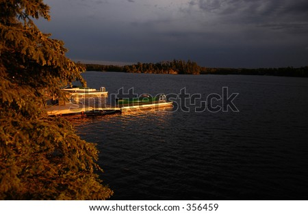 Rowboat parked at a pier on a lake,