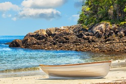 Rowboat pulled ashore onto the sandy beach of a secluded island