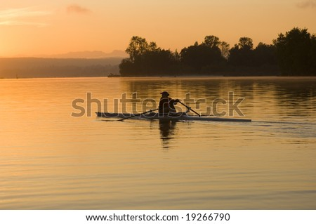 Rower at sunrise