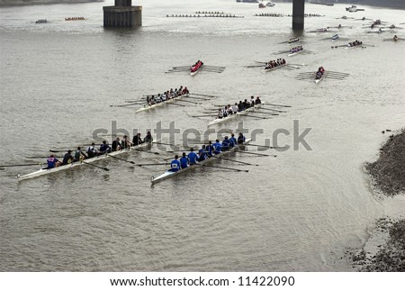 "Rowers in eight-oar rowing boats on River Thames in London, England – ""The Head of the River Race"""