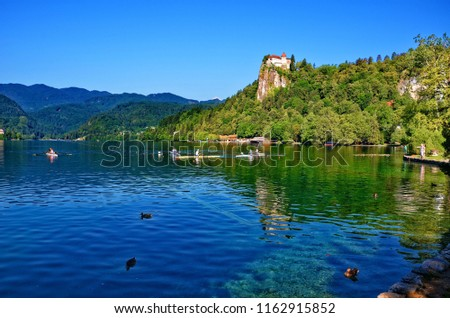 Rowers on the Lake Bled, Slovenia. Lake Bled with dominant Bled Castle is a major tourist attraction in Slovenia. The World Rowing Championships were held there several times.  #1162915852