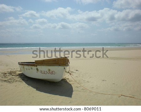 Rowing boat on a deserted beach