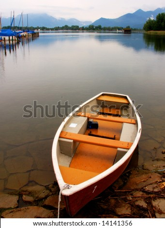 Rowing boat on the shore line of the Chiemsee in Germany