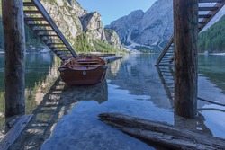 Rowing boats moored in an idyllic setting with dolomitic mountain background, Braies Lake, South Tyrol, Italy. Concept: relaxation in nature, famous natural places, film sets