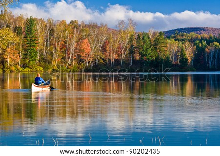 Rowing in Fall Colors - stock photo