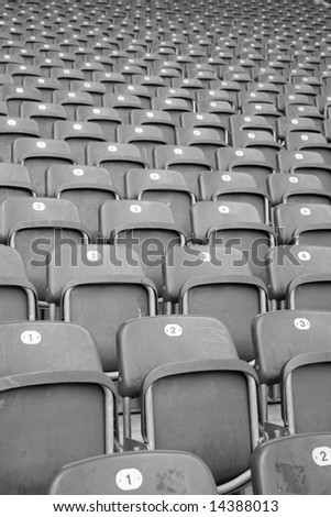 Rows and rows of empty seats in a football stadium