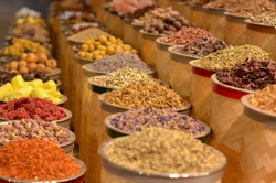 Rows & heaps of aromatic spices & herbs on display at the famous Spice Souk market in Baniyas Street, in locality of Al Ras, Deira, Dubai adjacent to the Gold Souk. It's a famous tourist destination