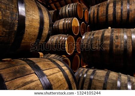 Rows of alcohol barrels in stock. Distillery. Cognac, whiskey, wine, brandy. Alcohol in barrels Imagine de stoc ©