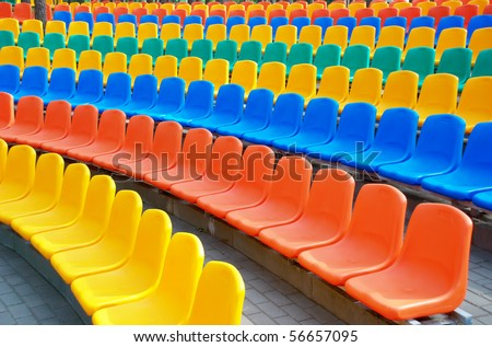 Rows of an empty colourful plastic seats