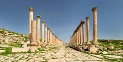 rows of antique colums in old city Jerash in Jordan