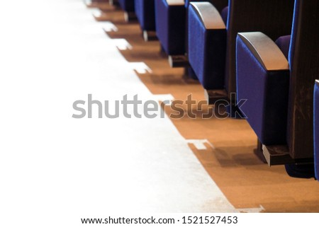 Rows of armchairs in a theater or cinema, back view. Concert seats
