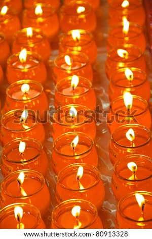 Rows of blessing candle offerings. Concept of buddhism ritual.