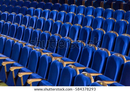 Rows of blue seats in the auditorium. Theater, cinema or circus. #584378293