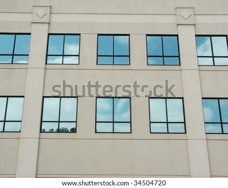 Rows of blue windows on a beige building
