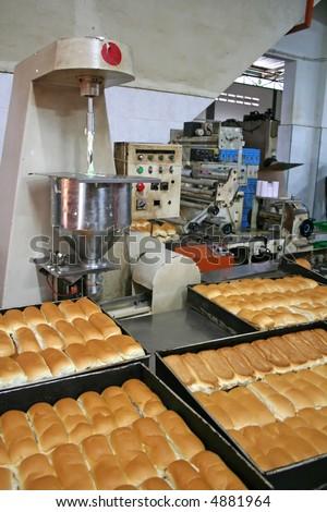 Rows of bread loaves in racks in a bakery