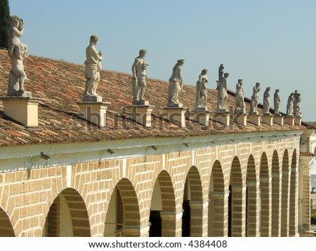 Rows of classic style statues above Villa Manin porch, Udine, Italy
