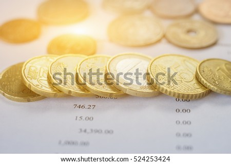 rows of coins for finance and...