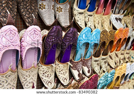 Rows of colorful shoes at the market in Dubai.