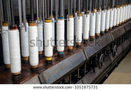 rows of cotton threads on...