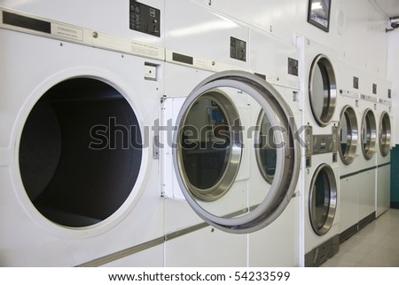 Rows of dryers at a laundry mat