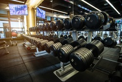 Rows of Dumbbells and Fitness Equipment in Gym - Sport and Health Care Concept