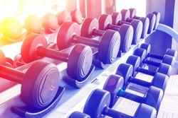 Rows of dumbbells in the gym with color filters