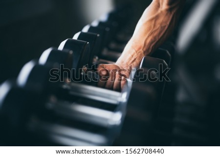 Rows of dumbbells in the gym with hand