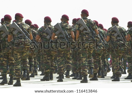 Rows of elite paratroopers in action on white background