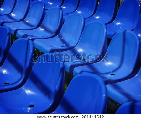 Rows of empty chairs prepared for a open air event