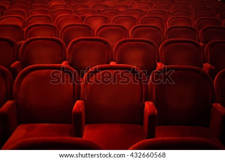 Rows of empty cinema or theater red seats