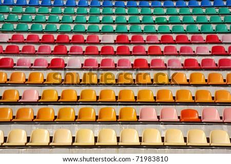 Rows of empty plastic stadium seats