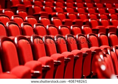 rows of empty red velvet seats...
